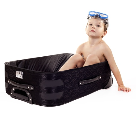 little boy sitting in the luggage wearing snorkel gear Stock Photo - 16878818