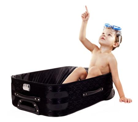 little boy sitting in the luggage wearing snorkel gear Stock Photo - 16878812