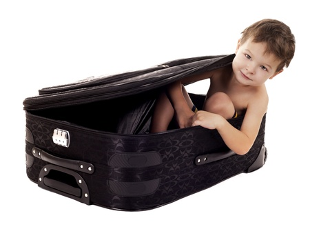 little boy sitting in the luggage on white background Stock Photo - 16878819