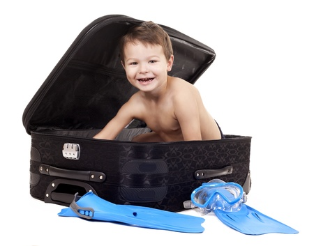 little boy sitting in the luggage wearing snorkel gear Stock Photo - 16878824