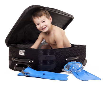 little boy sitting in the luggage on white background Stock Photo - 16878860