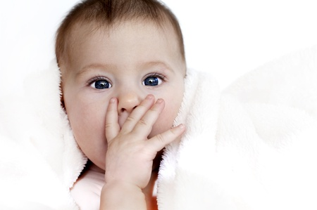 baby girl is wrapped in white blanket Stock Photo - 17573549