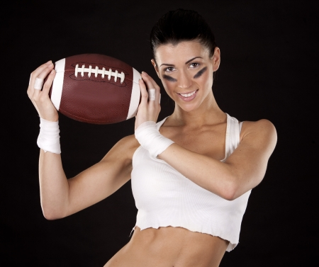 athletic brunette posing as american football girl on black background Stock Photo - 17573583