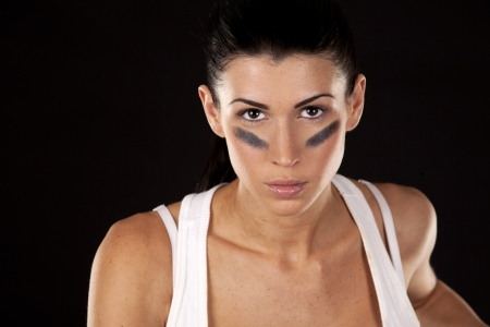 athletic brunette posing as american football girl on black background Stock Photo - 17573600