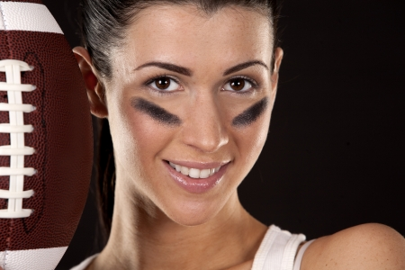 athletic brunette posing as american football girl on black background Stock Photo - 17573603