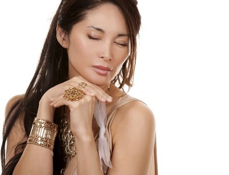 beautiful asian brunette wearing jewellery and fashin dress on white background photo