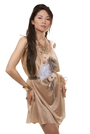 beautiful asian brunette wearing jewellery and fashin dress on white background Stock Photo - 17744655