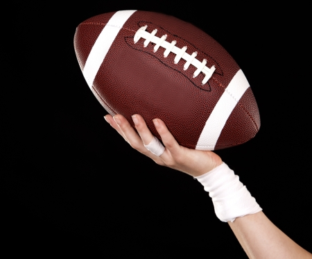 athletic woman holding a ball on black background Stock Photo - 17699095