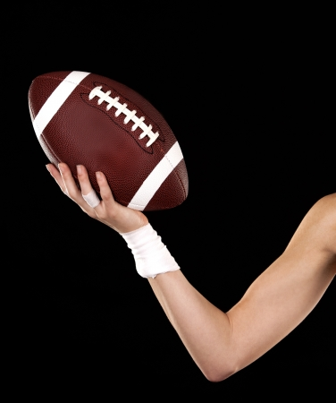 athletic woman holding a ball on black background Stock Photo - 17699072