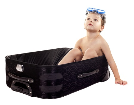 little boy sitting in the luggage wearing snorkel gear Stock Photo - 17699084