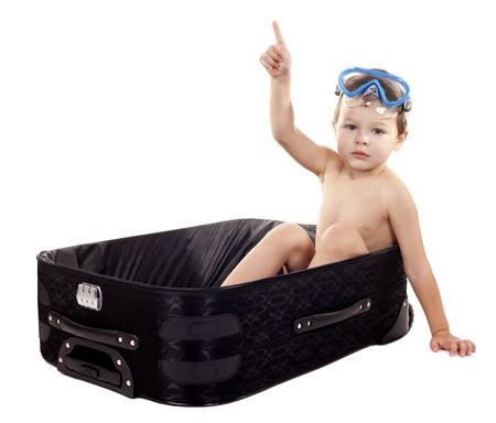 little boy sitting in the luggage wearing snorkel gear Stock Photo - 17699070