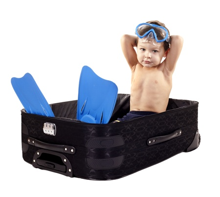 little boy sitting in the luggage wearing snorkel gear Stock Photo - 17699067