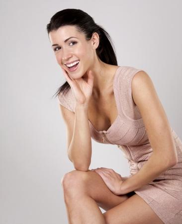 pretty brunette wearing pencil dress on light grey background Stock Photo - 17699141