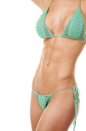 pretty fitness model posing in green bikini on white background Stock Photo