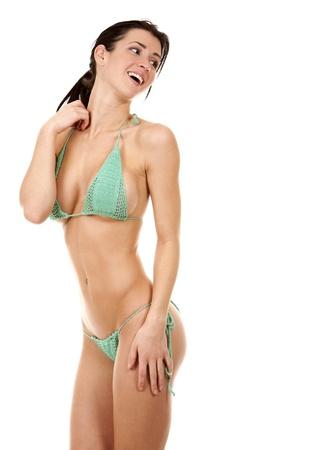 skinny girl: pretty fitness model posing in green bikini on white background Stock Photo