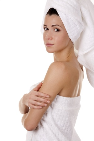 pretty brunette wearing white towel on white background Stock Photo - 17699105