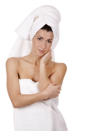 pretty brunette wearing white towel on white background Stock Photo - 17699096