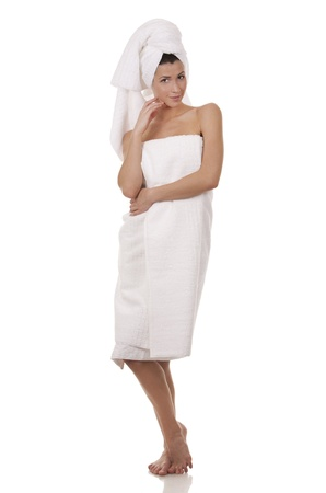 pretty brunette wearing white towel on white background Stock Photo - 17699066