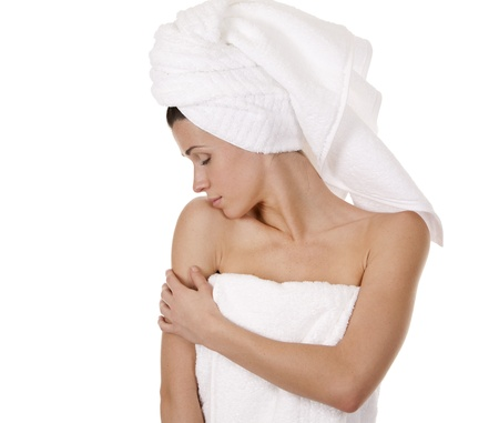 pretty brunette wearing white towel on white background Stock Photo - 17699069