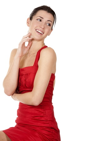 pretty brunette wearing red dress on white background Stock Photo - 17748711