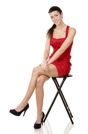 pretty brunette wearing red dress on white background Stock Photo - 17748720