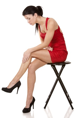 pretty brunette wearing red dress on white background Stock Photo - 17748726