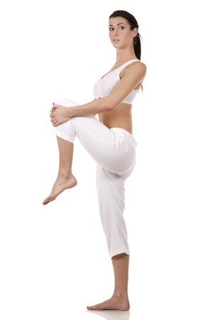 pretty brunette in white active wear on white background Stock Photo - 17748717