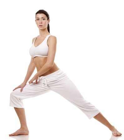 pretty brunette in white active wear on white background Stock Photo - 17748716