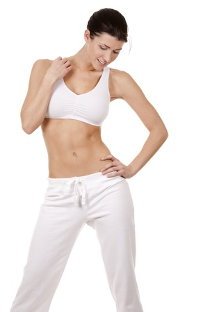 pretty brunette in white active wear on white background Stock Photo - 17748731
