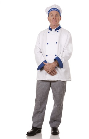 mature chef wearing workwear on white isolated background photo