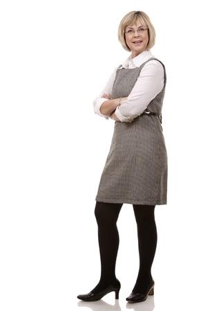 one senior adult woman: mujer madura rubia en el negocio desgaste en el fondo blanco