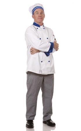 mature chef wearing workwear on white isolated background Standard-Bild