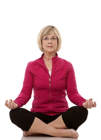 mature woman wearing fitness outfit on white isolated background