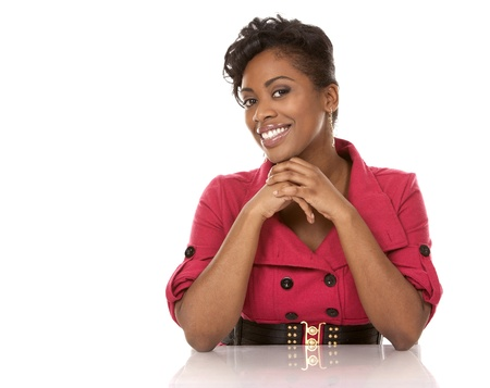 african business woman: pretty dark woman wearing red dress on white background