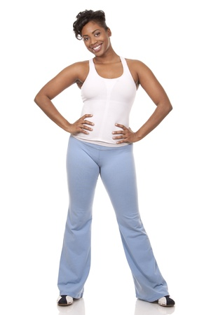 pretty black woman in active wear on white background Stock Photo - 18158611