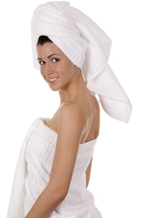 pretty brunette wearing white towel on white background photo