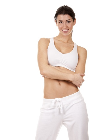 pretty brunette in white active wear on white background Stock Photo - 18335957
