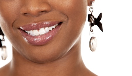 shiny black: pretty smile from black woman on white background