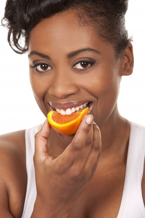black woman holding orange on white background Stock Photo - 18336016