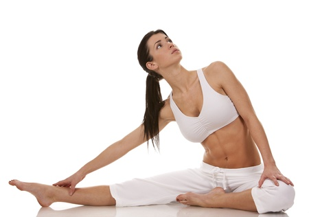 pretty brunette in white active wear on white background Stock Photo - 18468148