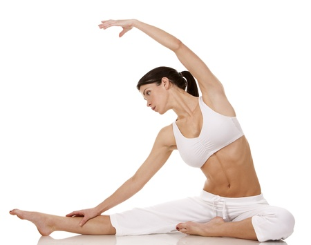 pretty brunette in white active wear on white background Stock Photo - 18468127