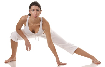 pretty brunette in white active wear on white background Stock Photo - 18468143