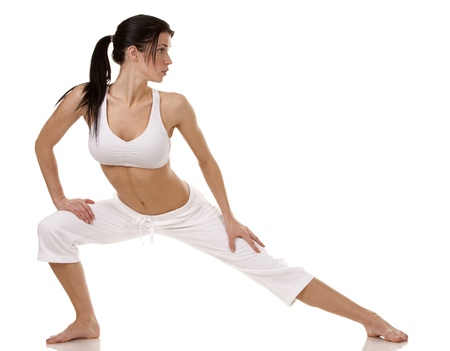 pretty brunette in white active wear on white background Stock Photo - 18468123
