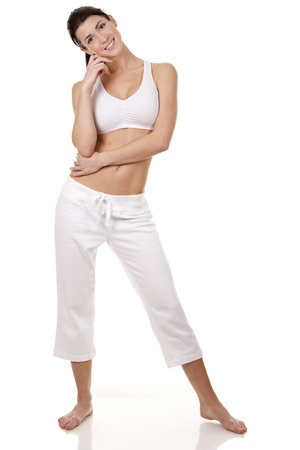 pretty brunette in white active wear on white background Stock Photo - 18468146