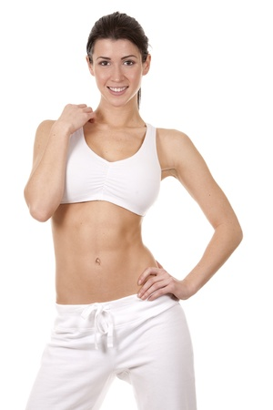 pretty brunette in white active wear on white background Stock Photo - 18468151