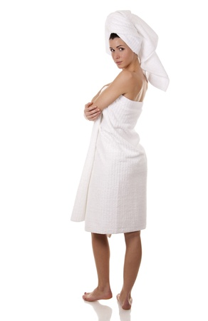 pretty brunette wearing white towel on white background Stock Photo - 18468138
