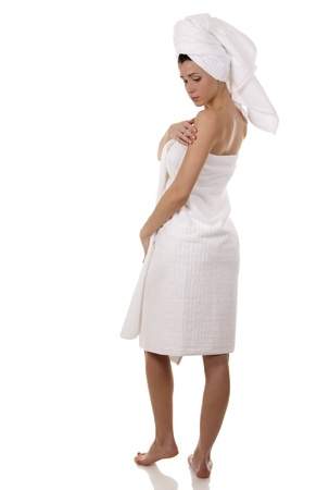 pretty brunette wearing white towel on white background Stock Photo - 18468140