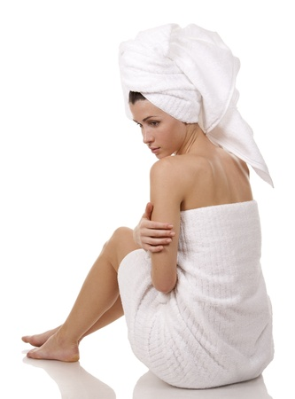 pretty brunette wearing white towel on white background Stock Photo - 18468150