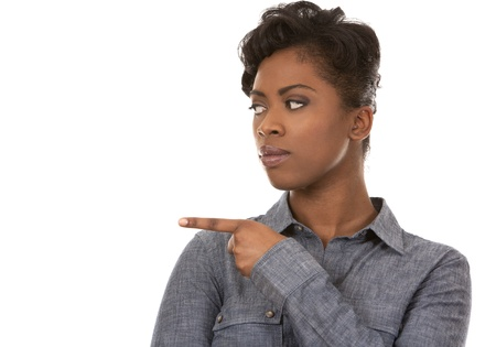 pretty casual black woman pointing with her arm on white background Stock Photo - 18468170