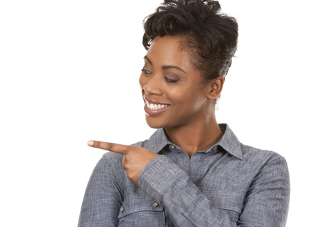 pretty casual black woman pointing with her arm on white background Stock Photo - 18453241